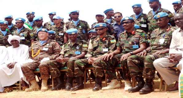 Rwandan peacekeepers in a group photo with UNAMID officials
