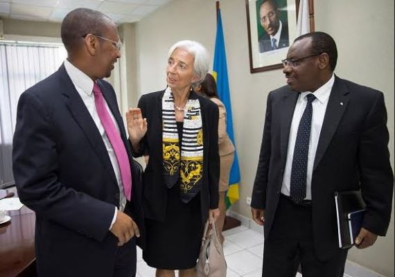 IMF Chief Christine Lagarde (c) during her visit to Rwanda in 2015, interacts with Finance Minister Claver Gatete and Governor John Rwangombwa of the National Bank of Rwanda