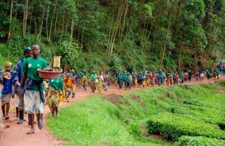 Rwandans Endure Heavy Downpour to Participate in Umuganda